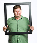 Peter Cleary holds a picture frame in Oxford, Miss. on Tuesday, August 30, 2011.