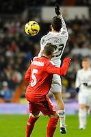 Real Madrid´s Isco and Sevilla's Diego Rosario during 2014-15 La Liga match between Real Madrid and Sevilla at Santiago Bernabeu stadium in Alcorcon, Madrid, Spain. February 04, 2015. (ALTERPHOTOS/Luis Fernandez) /NORTEphoto.com