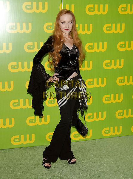 SCARLETT POMMERS.The CW Launch Party held at Warner Brothers' Studios in Burbank, California, USA..September 18th, 2006.Ref: DVS.full length black skirt skull print hand on hip top wide sleeves.www.capitalpictures.com.sales@capitalpictures.com.©Debbie VanStory/Capital Pictures