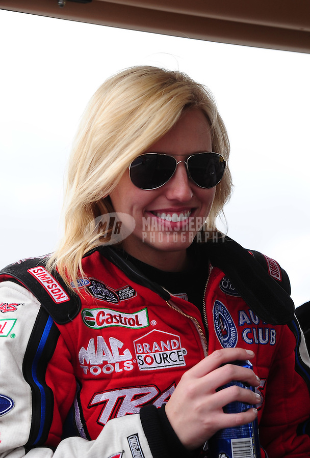 Feb. 12, 2012; Pomona, CA, USA; NHRA funny car driver Courtney Force during the Winternationals at Auto Club Raceway at Pomona. Mandatory Credit: Mark J. Rebilas-