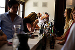 Guests mingle in the main tasting room at Francis Ford Coppola Winery, in Geyserville, Ca., on Saturday, July 31, 2010.