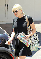 Pregnant Anna Faris spotted hugging a friend goodbye after lunch at Aroma Cafe and paying the valet. Los Angeles, California on 19.07.2012.Credit: Correa/face to face. / Mediapunchinc  **weekly magazines online only not for print*** /*NORTEPHOTO.com*<br />