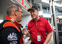 Oct 16, 2016; Ennis, TX, USA; NHRA president Peter Clifford (right) with top fuel driver Doug Kalitta during the Fall Nationals at Texas Motorplex. Mandatory Credit: Mark J. Rebilas-USA TODAY Sports