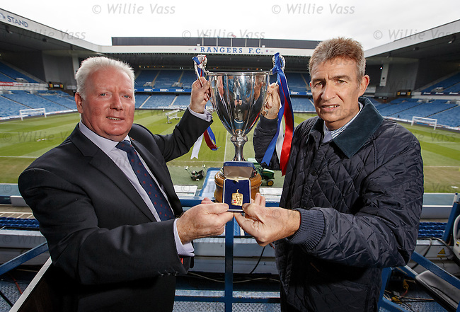 Sandy Jardine presents Alex MacDonald with a replica winners medal from the 1972 Cup Winners Cup Final to replace the original which was stolen