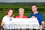 Ted and Fiona Clifford Currow presents a cheque of €2950 to Eileen Ní Mhurchú for the Jack and Jill foundation at their home on Monday evening