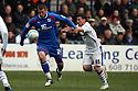 Michael Bostwick of Stevenage escapes from David Buchanan of Tranmere. - Tranmere Rovers v Stevenage - npower League 1 - Prenton Park, Tranmere - 6th April, 2012 . © Kevin Coleman 2012