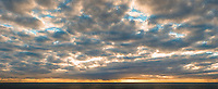 Sun sets over Tasman Sea, illuminating clouds, Westland Tai Poutini National Park, UNESCO World Heritage Area, West Coast, New Zealand, NZ