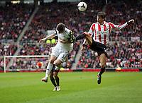 Pictured: Santiago Vergini of Sunderland (R) fouls Ben Davies of Swansea (L). Sunday 11 May 2014<br /> Re: Barclay's Premier League, Sunderland v Swansea City FC at the Stadium of Light, Sunderland, UK.