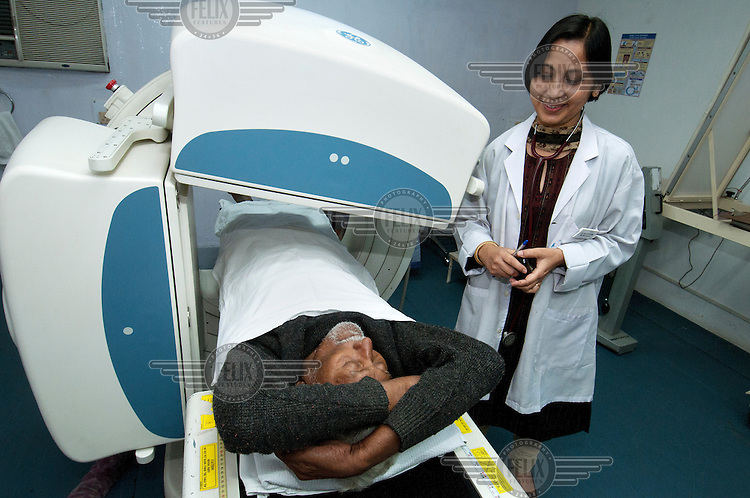 A patient undergoes a cat scan in the department for nuclear medicine at the Tata Main Hospital.