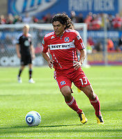 Chicago Fire defender Deris Umanzor (13) dribbles the ball down the field.  The Chicago Fire tied DC United 0-0 at Toyota Park in Bridgeview, IL on Oct. 16, 2010.