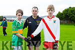 Captain of John Mitchells  Patrick O'Brien, Referee Paul Hayes and An Ghaeltacht's captain Cathal Begley start the first game on the Bishop Pitch at the Lee Strand Invitational Tournament in Austin Stacks GAA Connolly Park on Saturday