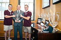 Mississippi State University baseball players Josh Lovelady (left) and Cody Brown (right) present the Governor&rsquo;s Cup trophy to MSU President Mark E. Keenum. The Bulldogs earned the trophy by defeating the University of Mississippi in the annual Governor&rsquo;s Cup game at Trustmark Park in Pearl. The baseball Bulldogs swept the 2017 regular season matchups against the Rebels 4-0.<br />