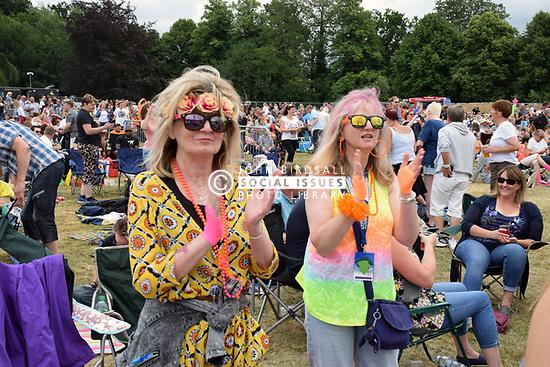 People enjoying themselves at Let's Rock, 1980s retro music festival, Earlham Park, Norwich UK 24 June 2017 UK