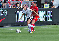 02 June 2013: U.S. Women's National Team defender Whitney Engen #14 and Canadian Woman's National Team player Melissa Tancredi #14 in action during an International Friendly soccer match between the U.S. Women's National Soccer Team and the Canadian Women's National Soccer Team at BMO Field in Toronto, Ontario.<br /> The U.S. Women's National Team Won 3-0.