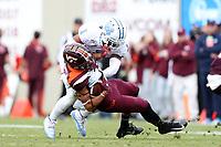 BLACKSBURG, VA - OCTOBER 19: Myles Dorn #1 of the University of North Carolina tackles Kaleb Smith #80 of Virginia Tech during a game between North Carolina and Virginia Tech at Lane Stadium on October 19, 2019 in Blacksburg, Virginia.