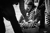 Rebel fighters prepare bullets outside of Ajdabiya, Libya.
