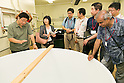 Isawa Heizo (L), President of Katsuyama Supreme SAKE Co., Ltd. gives a tour to members of the press as part of the ''1000km Relay to Tokyo 2016'' promotion event in Sendai City on July 30, 2016, Miyagi, Japan. The sake brewery factory received the Gold Medal of Junmai Ginjo category at the International Wine Challenge 2016 Award for its flagship sake ''Akatsuki'' on July 29, 2016. The sake brewery was established over 320 years ago and is expanding to market their products overseas. (Photo by Rodrigo Reyes Marin/AFLO)