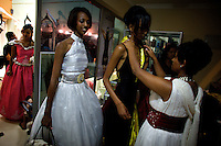 A stylist works on a contender for the crown while another waits for her turn during the 2009 Miss Ethiopia beauty pageant held at the Intercontinental Hotel in Ethiopia's Capital Addis Ababa on Sunday January 18 2009.