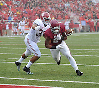 NWA Media/Michael Woods --10/11/2014-- w @NWAMICHAELW...University of Arkansas running back Kody Walker fumbles the ball as he is tackled by Alabama defender Trey DePriest during the first quarter of Saturdays game at Razorback Stadium in Fayetteville.
