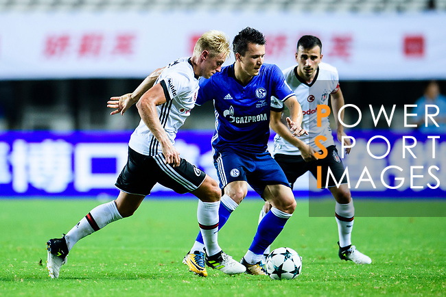 Besiktas Istambul Defender Andreas Beck (L) plays against FC Schalke Midfielder Yevhen Konoplyanka (C) during the Friendly Football Matches Summer 2017 between FC Schalke 04 Vs Besiktas Istanbul at Zhuhai Sport Center Stadium on July 19, 2017 in Zhuhai, China. Photo by Marcio Rodrigo Machado / Power Sport Images