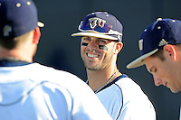 5 May 2012:  FIU's Mike Martinez (40) enjoys a light moment with teammates prior to the game as the FIU Golden Panthers defeated the Middle Tennessee State University Blue Raiders, 12-6, at University Park Stadium in Miami, Florida.  With his first inning single, Martinez became FIU's all-time hit leader.