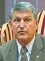 United States Senator Joe Manchin III (Democrat of West Virginia) speaks to reporters as he meets Judge Merrick Garland, chief justice for the US Court of Appeals for the District of Columbia Circuit, who is US President Barack Obama's selection to replace the late Associate Justice Antonin Scalia on the US Supreme Court during a photo op and conversation in the Senator's office Capitol Hill in Washington, DC on Tuesday, April 5, 2016. Photo Credit: Ron Sachs/CNP/AdMedia