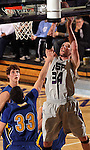 SIOUX FALLS, SD - JANUARY 17:  David Maxwell #34 from the University of Sioux Falls takes the ball strong to the hoop against Jesse Bean #33 from Dakota State University in the first half of their game Tuesday night at the Stewart Center. (Photo by Dave Eggen/Inertia)