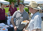 Gerry Harrington, who coordinated the Health Alliance Group's participation in Health Day theme, talking with Market Committee member, John Bassler, at the Saugerties Farmer's Market on Main Street in the Village of Saugerties, NY, on Saturday, June 10, 2017. Photo by Jim Peppler. Copyright/Jim Peppler-2017.