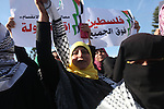 """Palestinian women chant slogans during a protest calling for unity and to end the internal Palestinian division in Gaza City, Tuesday, Dec. 18, 2012. Arabic on the poster, left, reads,"""" Palestine is above all,"""" and at right, """"the woman is the candle that burns for the country."""" . Photo by Majdi Fathi"""