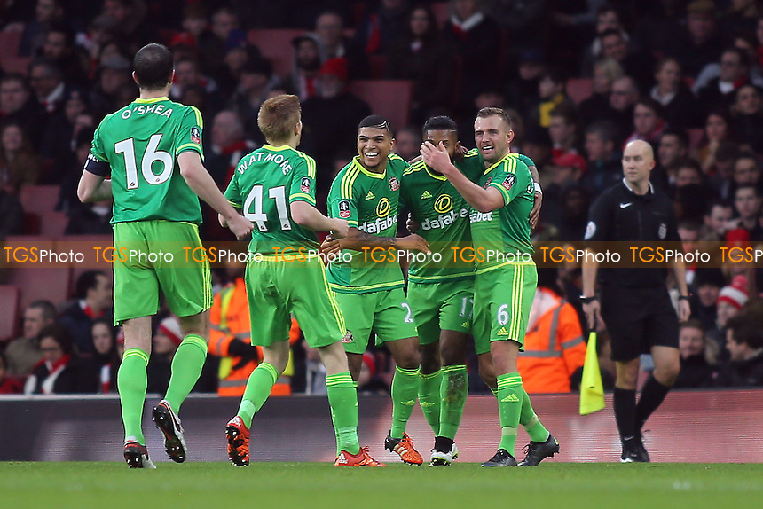Sunderland players celebrate their opening goal scored by No 17, Jeremain Lens during Arsenal vs Sunderland AFC at the Emirates Stadium