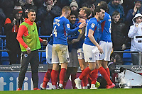 Goalscorer Ellis Harrison of Portsmouth  middle is mobbed after scoring the first goal of the match during Portsmouth vs Shrewsbury Town, Sky Bet EFL League 1 Football at Fratton Park on 15th February 2020