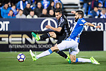 Lucas Vazquez of Real Madrid competes for the ball with Lluis Sastre Reus of Deportivo Leganes during their La Liga match between Deportivo Leganes and Real Madrid at the Estadio Municipal Butarque on 05 April 2017 in Madrid, Spain. Photo by Diego Gonzalez Souto / Power Sport Images