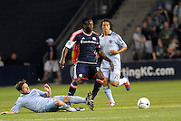 Shalrie Joseph (21) New England midfielder evades the tackle from Sporting KC's Bobby Convey... Sporting Kansas City defeated New England Revolution 3-0 at LIVESTRONG Sporting Park, Kansas City, Kansas.