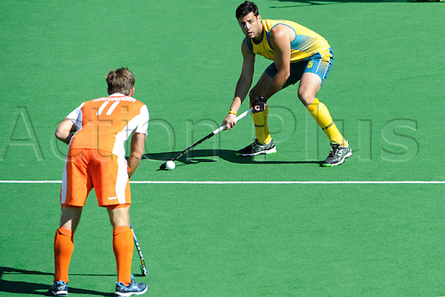 02.12.2012 Melbourne, Australia. Christopher Ciriello of Australia prepares to shoot while Jeroen Hertzberger of the Netherlands looks on during the Men's Hockey Champions Trophy from the State Netball Hockey Centre.