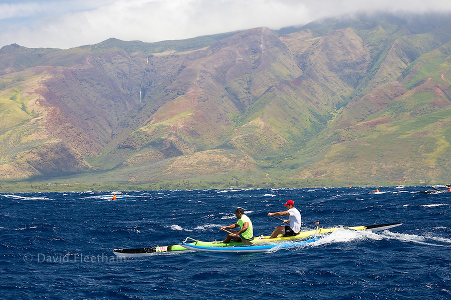 The two man paddle team of Mark Shimer and Bear Keahi (both MR) in the Maui Canoe and Kayak Club's 2014 Maui to Molokai race from DT Fleming Beach to Kaunakakai Harbor, Hawaii.  The island of Molokai is in the background.