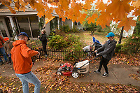 NWA Democrat-Gazette/BEN GOFF @NWABENGOFF<br /> Members of the Suggs family of Lewisville, Texas, and the Courtney family of Rogers rake up leaves Saturday, Nov. 3, 2018, at Nicole's House in Rogers. The two families were volunteering to do fall yardwork at the transitional living facility for women recovering from drug and alcohol addiction.