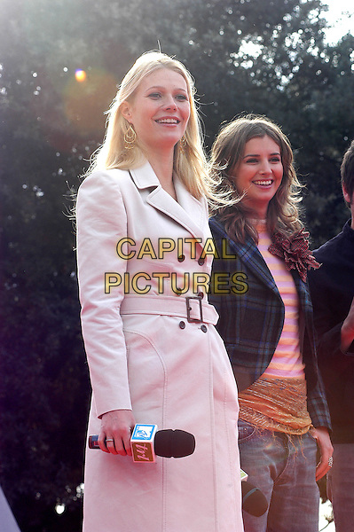 GWYNETH PALTROW.Opening MtV Music Pollination Week on MTV's TRL programme at Pincio in Rome, Italy..November 10th, 2004.half length, white jacket, coat, mac, microphone.www.capitalpictures.com.sales@capitalpictures.com.© Capital Pictures.