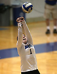 Marymount's Cassidie Watson reaches for a ball during a college volleyball match at Washington &amp; Lee University Lexington, Vir., on Saturday, Oct. 5, 2013.<br /> Photo by Cathleen Allison