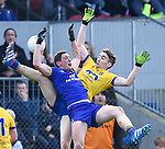 Cathal O Connor of Clare in action against Cathal Compton of Roscommon during their National League game at Cusack Park. Photograph by John Kelly.