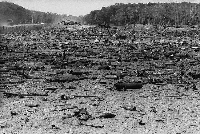 Hundreds of shell casings line the road where North Vietnamese gunners attacked South Vietnamese convoys making their way south from the DMZ towards Quang Tri during the Easter Offensive. South Vietnam, May 1972