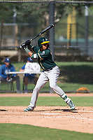 Oakland Athletics shortstop Jhoan Paulino (17) at bat during an Instructional League game against the Los Angeles Dodgers at Camelback Ranch on October 4, 2018 in Glendale, Arizona. (Zachary Lucy/Four Seam Images)