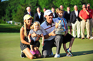 Bethesda, MD - June 29, 2014: Justin Rose posses for a family photo after winning the Quicken Loan National at Congressional Country Club in Bethesda MD. The win gives Rose a total of six PGA Tour titles. (Photo by Phillip Peters/Media Images International)