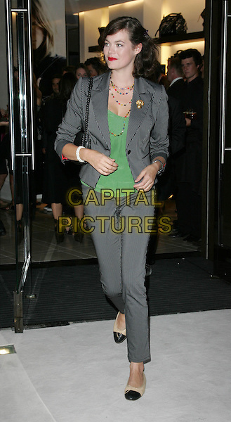 JASMINE GUINNESS.Vogue 'Fashion's Night Out ' launch at Burberry's store in New Oxford Street, London, England..September 10th 2009.full length grey gray pinstripe trousers jacket green black two tone flats pumps shoes beige .CAP/ROS.©Steve Ross/Capital Pictures.