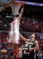 Ohio State Buckeyes guard Lenzelle Smith Jr. (32) goes up for a slam dunk over Bryant University Bulldogs guard Dyami Starks (12) during Wednesday's NCAA Division I basketball game at Value City Arena in Columbus on December 11, 2013. (Barbara J. Perenic/The Columbus Dispatch)