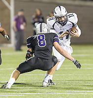 McNeil's quarterback Hayden Cooper gets stopped by Cedar Ridge's Spencer Engelke Thursday at Kelly Reeves Athletic Complex.  (LOURDES M SHOAF for Round Rock Leader)