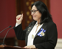 Singer Nana Mouskouri waves to the crowd as she receives the Ordre National du Quebec during a ceremony Tuesday May 28, 2013 at the legislature in Quebec City.
