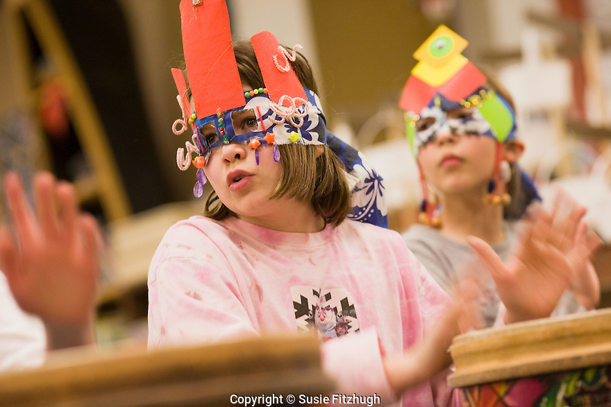 Children in Arts Corps teaching artist Monad Elohim's drumming class at Kimball Elementary School, in their home-made costumes for a coming performance.