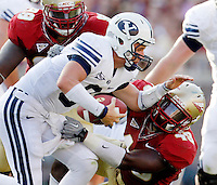 TALLAHASSEE, FL 9/18/10-FSU-BYU FB10 CH-Florida State's Jacobbi McDaniel, left, closes as Brandon Jenkins tackles Brigham Young quarterback Jake Heaps during second half action Saturday at Doak Campbell Stadium in Tallahassee. The Seminoles beat the Cougars 34-10..COLIN HACKLEY PHOTO