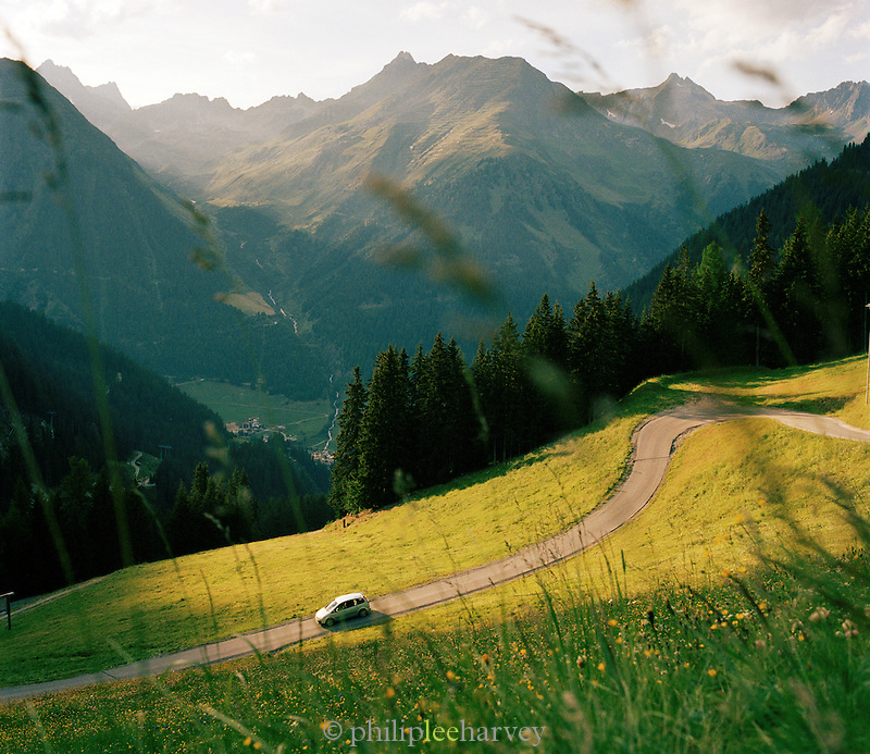 Car driving along a high Alpine road, Ischgl, Austrian Tirol, Austria.