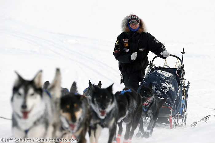 Matt Failor walks up the bank of the Yukon River into the Kaltag checkpoint with his team on Sunday March 10, 2013...Iditarod Sled Dog Race 2013..Photo by Jeff Schultz copyright 2013 DO NOT REPRODUCE WITHOUT PERMISSION
